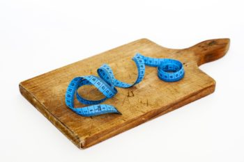 blue-measuring-tape-on-wooden-chopping-board