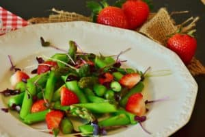 greens-with-strawberry-on-a-plate-healthy-food